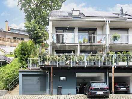 Ferien im eigenen Haus: Moderne 5-Zi.-DHH mit 2 Balkonen nur einen Steinwurf vom Strand entfernt