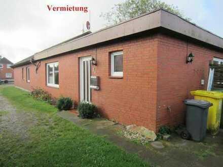 Kleine Doppelhaushälfte mit Kaminofen