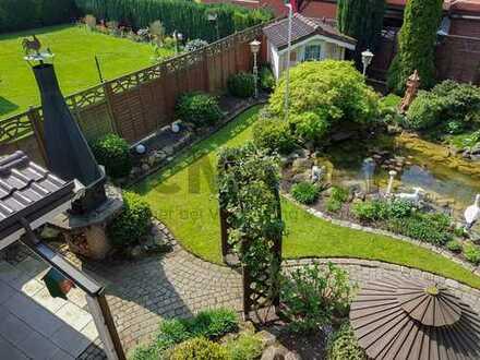 Exklusives Schmuckstück: EFH mit verträumtem Garten, Jägerhütte, 2 Terrassen und 2 Garagen