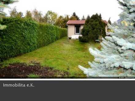 Kleiner Bungalow mit Ausbaupotenzial und pflegeleichtem Garten