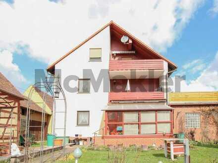 EFH mit vermieteter DG-Wohnung und Nebengebäude - Ausbaufähig für private und gewerbliche Zwecke