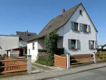 Weiterstadt-Mitte!**Sanierungsbedürftiges kleines Zweifamilienhaus mit Garten**