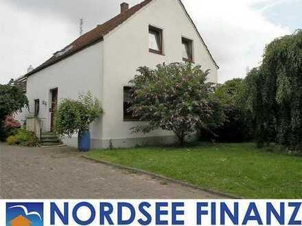 PREISSENKUNG !!!: Das geräumige Einfamilienhaus liegt reizvoll in Wesernähe. Einer jungen Fami