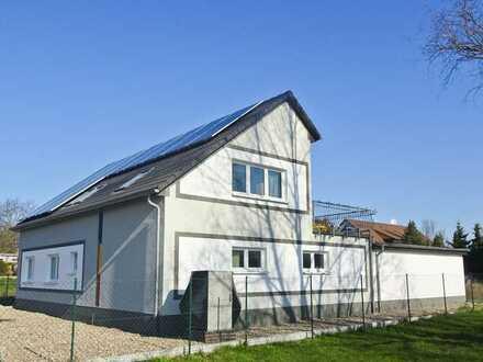 Attraktives Niedrigenergiehaus mit Wohnung und separater Büroenheit