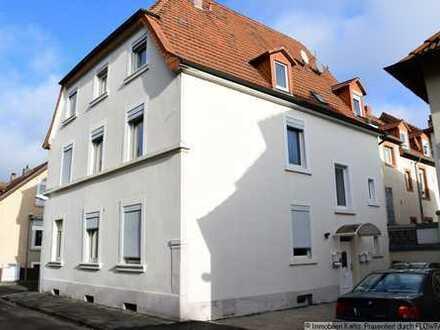 Stilvolles Mehrfamilienhaus mit Nebengebäude in Zentrumsnähe