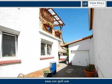Wohnen in Feldrandlage mit Kaminofen, Einzelgarage und Ausbaureserve