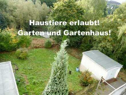 Dachgeschosswohnung mit Garten und Garage!