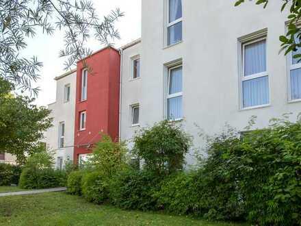 Freundliche, helle 3-Zimmer-Wohnung mit Terrasse und Gartenanteil