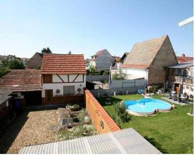 Mehrfamilienhaus mit Potential / großen Garten & Hinterhofbebauung