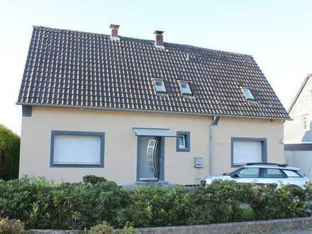 Freistehendes Einfamilienhaus mit Wintergarten und Garage in erstklassiger ruhiger Lage