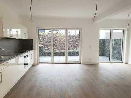 Erstbezug: Lichtdurchflutete Souterrain Wohnung mit hohen Decken und großer Loggia!