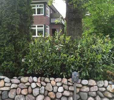 Haushälfte mit 3 attraktiven Wohnungen auf Parkgrundstück