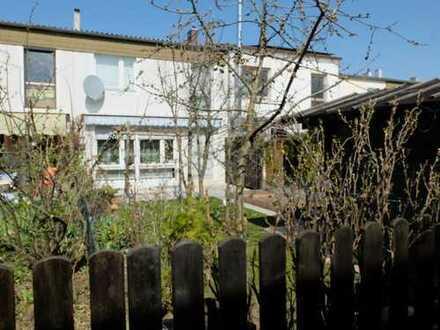 Sonniges, teilweise modernisiertes Reihenmittelhaus mit guter Raumaufteilung und hübschen Garten!