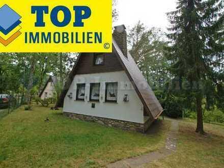 Seenähe (ca. 350 m). Klein-Haus (ca. 34 m²) auf Baugrundstück. Ruhig und grün. Bauträgerfrei.