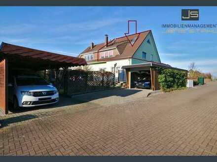 Eigentumswohnung mit kleinem Gartenbereich & Carport