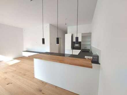 Wunderhübsche 3-Zi-Neubauwohnung mit Sonnenterrasse Einbauküche und Tiefgarage