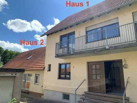 Zwei Häuser... ein Preis ! Ansprechendes Häuserduo mit Garten, Hof und Garagengebäude im Ortskern