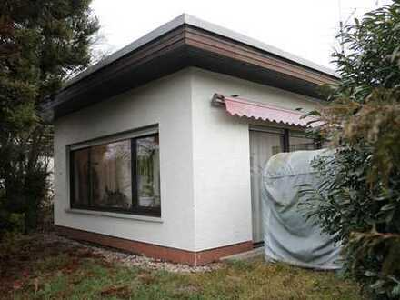 Wohnen auf einer Ebene: Winkelbungalow in Buseck, ruhige Ortsrandlage