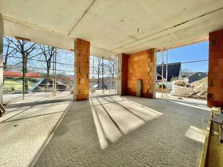 **Exklusive Neubau-Eigentumswohnung mit Garage in sonniger und zentraler Lage**