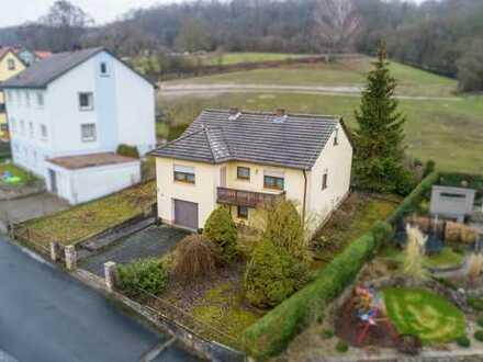 Einfamilienhaus im Grünen mit viel Potential