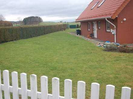 3-Zimmer-Wohnung im Zweifamilienhaus mit Balkon und Garten