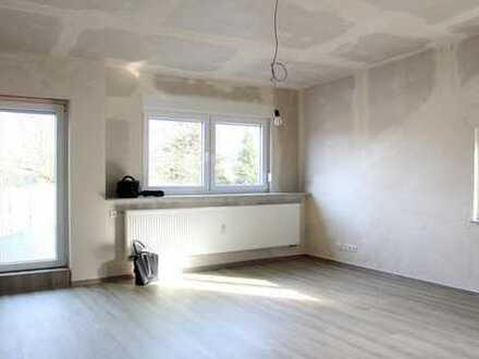 Sanierte 3-Zimmer-Dachgeschosswohnung mit Dachterrasse und Garage