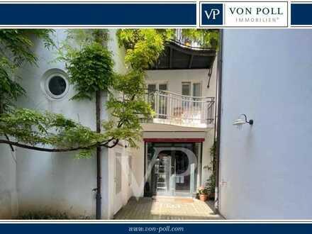 VON POLL IMMOBILIEN: Loftateliers mit 40 m² Garten in ruhiger Lage