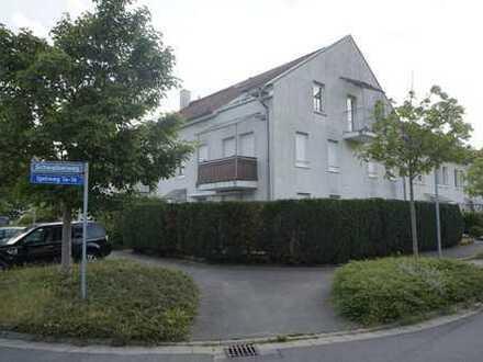 Gut vermietete Erdgeschosswohnung mit begrünter Terrasse und Tiefgaragenplatz