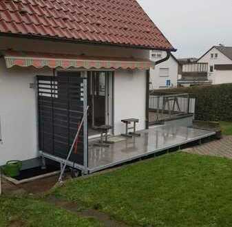 Wohnen in gemütlicher Wohnung mit Garten und Terrasse