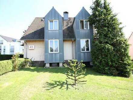 Stilvolles Anwesen in bevorzugter Wohnlage! Einfamilienhaus mit 2 Garagen und großem Garten