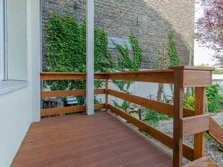 Erdgeschoss-Wohnung mit Balkon und Garten in zentraler Stadtlage