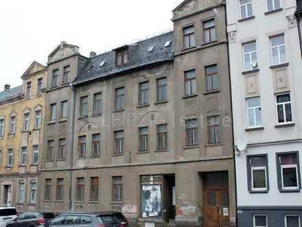 unsaniertes Mehrfamilienhaus mit Gewerbeeinheit und guter Bausubstanz