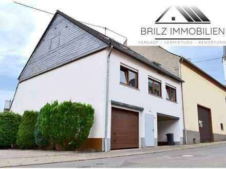 Modernisiertes 1-2-Familienhaus im idyllischen Bergen