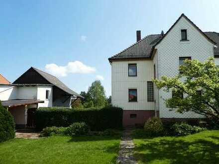 AUMÜLLER-Immobilien - Charmante Doppelhaushälfte mit Werkstatt, Garage und sonnigem Garten