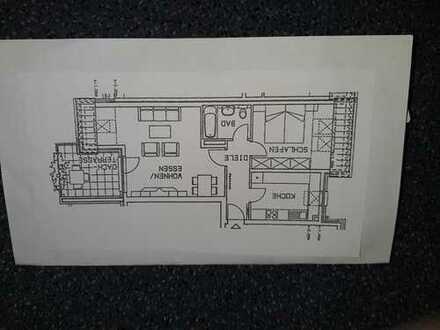 2-Zimmer-Dachgeschosswohnung mit Dachterrasse in gepflegter Anlage, ggf. TG Platz