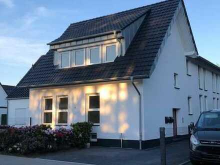 Erstbezug mit Terrasse und eigenem Garten: exklusive 5-Zimmer-EG-Wohnung in Bonn-Röttgen
