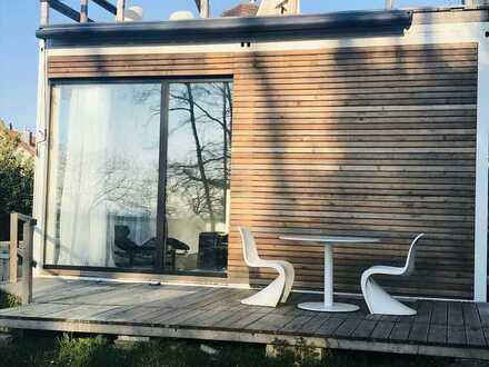 Exklusiv möbliertes 2-Zimmer Loft mit elektrisch verschiebbaren Zimmern ,Terrasse und Garten