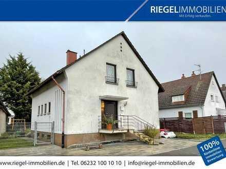 Sie hier? Wir auch! 510,00 m² Grundstücksgröße, Einfamilienhaus mit Garage in angenehmer Wohnlage