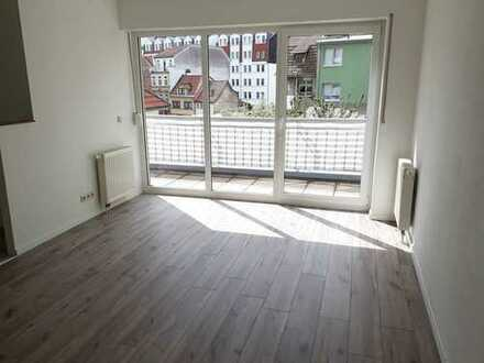 Große Fenster fluten die Räume mit viel Licht