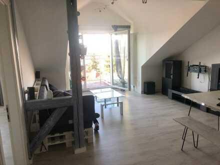 modernisierte 2-Zimmer-Dachgeschosswohnung mit Balkon und Einbauküche in Ansbach
