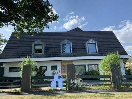 Markantes, außergewöhnliches Einfamilienhaus mit offener Galerie in bester Lage von Baunatal!