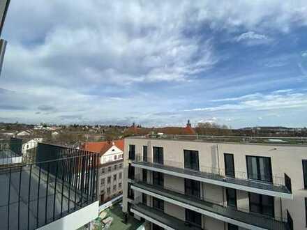 Hier wohnen Sie ganz oben: 2-Zimmer mit Balkon * offene Küche * Erstbezug