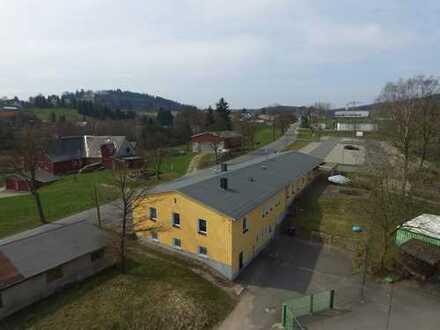 Gebäude für Einzelhandel, Lager, Produktion + Wohnung