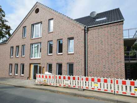 Barrierefreie Neubauwohnung mit Balkon im Ortskern von Capelle!