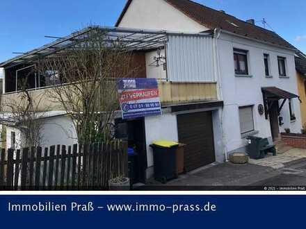 Einfamilienhaus mit Garage und zusätzlichem seperatem Gartengrundstück in Callbach zu verkaufen