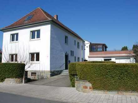 Wohnung mit eigenem Garten, Garage und Ausbaupotential