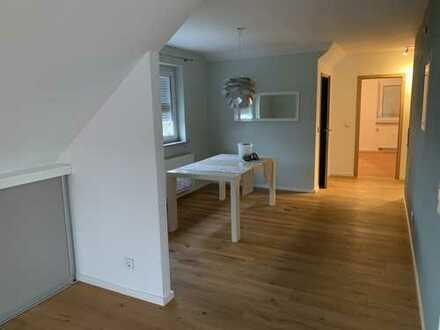 Exklusive Dachgeschosswohnung in Spitzenlage