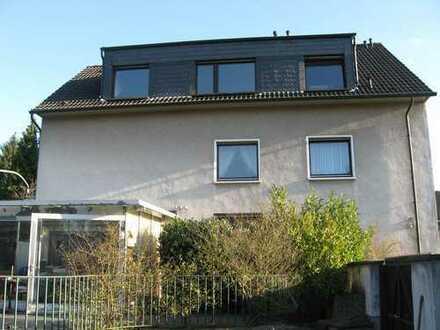 Dachgeschosswohnung mit Balkon und Gartenblick