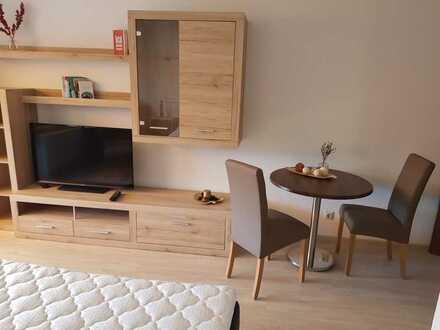Exklusive 1 Zimmerwohnung vollmöbliert mit separater Küche und Bad, tolle Aussichtslage mit Balkon