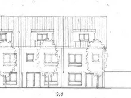 Modernes Neubauvorhaben: Reihenendhaus mit Terrasse, Stellplatz und Garage.